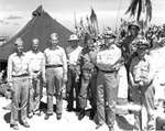 Spruance, Conolly, Forrestal, Schmidt, Smith, Moreel, Carlson, and Pownall at Kwajalein Atoll, Feb 1944, photo 1 of 2