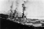 Buildings in Dutch Harbor in flames after Japanese strike, 3 Jun 1942