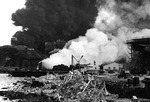 Burning ship and oil storage at Dutch Harbor, US Territory of Alaska, 4 Jun 1942, photo 1 of 2