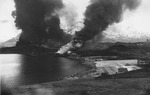 Burning ship and oil storage at Dutch Harbor, US Territory of Alaska, 4 Jun 1942, photo 2 of 2