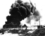 Oil tanks burning on Sand Island of Midway Atoll after Japanese attack, 4 Jun 1942