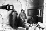 German paratroopers in the cellar of a destroyed house in Cassino, Italy, 1944, photo 2 of 3