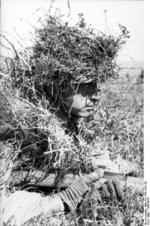 Camouflaged German paratrooper at Monte Cassino, Italy, 1943-1944