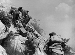 Polish troops carrying ammunition to the front lines, near Cassino, Italy, May 1944