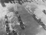 US Navy LCI(L) ships unloading men at Morotai, 15 Sep 1944