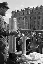 Soviet soldier teaching civilians how to disarm a un-exploded German incendiary bomb, Sverdlov Square, Moscow, Russia, 1 Sep 1941