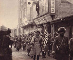 Japanese troops marching into an identified town, northeastern China, circa Sep-Oct 1931