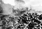 Spent 75-mm howitzer shells piling up outside the besieged city Myitkyina, Burma, mid-1944; note M1 carriage