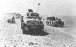 German vehicles of 21st Panzer Division on the move in North Africa, 1942