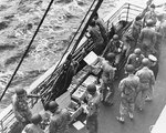 US Army troops of the 3rd Infantry Division drew ammunition on board USS Joseph T. Dickman (AP-26), off Morocco, 7 Nov 1942