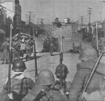 Japanese troops attacking the Zhonghua Gate of the Nanjing city wall with a field gun, China, 12 Dec 1937