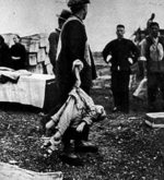 Chinese self-organized burial team taking care of the remains of a slain child, Nanjing, China, Jan 1938