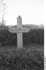 Grave marker for 13 German civilians killed by Soviets, Nemmersdorf, East Prussia, Germany, late Oct 1944, photo 1 of 2