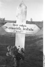 Grave marker for 24 German civilians killed by Soviets, Nemmersdorf, East Prussia, Germany, late Oct 1944, photo 2 of 3