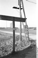 Road sign near Nemmersdorf, East Prussia, Germany, late Oct 1944, photo 2 of 2