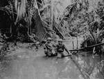 US Signal Corps cameramen Carl Weinke and Ernest Marjoram in New Guinea stream, 22 Apr 1944