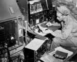 US Army radioman Corporal John Robbins operating his SCR 188, Dobodura, New Guinea, 9 May 1943