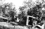 Destroyed Japanese trucks, Buna, Australian Papua, mid-1943