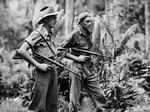 Australian Privates Leon Ravet of Parramatta and Bernard Kentwell on patrol with Owen Machine Carbines, New Britain. 4 April 1945