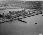 View of the railway ferry terminal in Cherbourg harbor, 29 Jul 1944