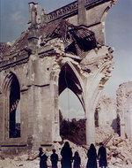 Two Nuns and a French family examined the ruins of the bombed Église Saint-Malo, Valognes, France, Jul 1944