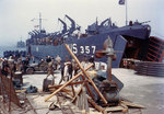 LST-357 loading vehicles in an English port, in preparation for the invasion of France, circa late May or early Jun 1944
