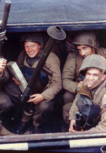 US Army Rangers awaited the invasion signal in a landing craft in an English port, circa early Jun 1944, photo 1 of 2; note the bazooka and the M1 Garand rifles
