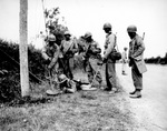 African-American soldiers of the US Army bring taught how to detect and disarm mines, France, 13 Jul 1944