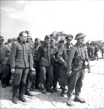 Two German officers in a group of prisoners who surrendered to the Canadians in Bernières-sur-mer, Normandy, France, 6 Jun 1944