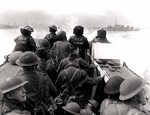 Canadian infantrymen aboard a landing craft launched from HMCS Prince Henry, off Normandy beach, France, 6 Jun 1944
