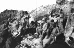 US Army soldiers resting at Pointe du Hoc, Normandy, France, 6 Jun 1944