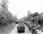 US Army soldiers and jeeps on their way to the front lines, Saint-Lô, France, Jul 1944