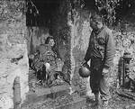Captain Earl Topley looking at a German soldier who had killed three of his men before his own death, Cherbourg, France, 27 Jun 1944