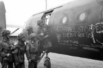 British airborne troops admiring the graffiti chalked on the side of their Horsa Mk I glider, 6 Jun 1944