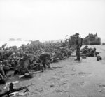 British troops crouching down on Sword Beach, Normandy, France, 6 Jun 1944