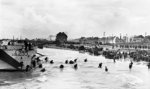 Men of Canadian 9th Infantry Brigade disembarking from LCI(L) landing craft onto Nan White Beach near Bernières-sur-Mer, Juno Beach, Normandy, France, late morning 6 Jun 1944; note many with bicycles. Photo 1 of 2.
