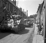Sherman tanks of UK 30th Corps passing through Bayeaux, France, 17 Jun 1944
