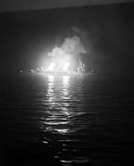 Cruiser HMS Belfast bombarding German positions off Normandy, France, 24-25 Jun 1944