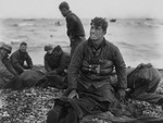 US Army soldiers recovering remains of comrades at Omaha Beach, Normandy, France, 6 Jun 1944
