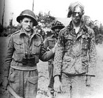 A Hitler Youth soldier captured by Canadian soldiers, Caen, France, 9 Aug 1944