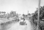 American soldiers and vehicle in Ballon, France, circa 18-20 Aug 1944