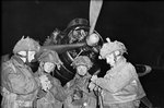 British Pathfinders synchronizing their watches in front of an Armstrong Whitworth Albemarle aircraft, 5 Jun 1944