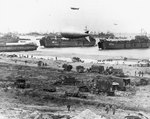LSTs landing vehicles and cargo on a Normandy beach, June 1944, photo 2 of 2