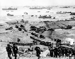 Reinforcements of men and equipment moving inland at Omaha Beach, Normandy, 8 Jun 1944