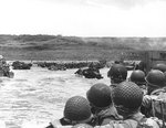 American troops watched activity ashore on Omaha Beach as their LCVP landing craft approached the shore, Normandy, 6 Jun 1944, photo 2 of 2