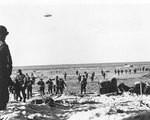 Newly landed US troops moved along Utah Beach at Les Dunes de Madeleine, Normandy, 12 Jun 1944
