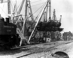 An American locomotive was transferred from SS Seatrain Texas, Cherbourg, 13 Jul 1944, to replace one of the many destroyed during the Allied invasion of Normandy, photo 1 of 2