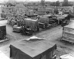 Tractors hauled supplies around an overflow materiel yard in England, which held supplies exceeding the capacity of Normandy yards, 28 Jul 1944