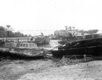 Wrecked American and British landing craft after a storm, Omaha Beach, Normandy, 21 Jun 1944