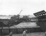 LCT-25 and LCI(L)-497 lay wrecked off Omaha Beach, Normandy, amidst a storm, 21 Jun 1944
